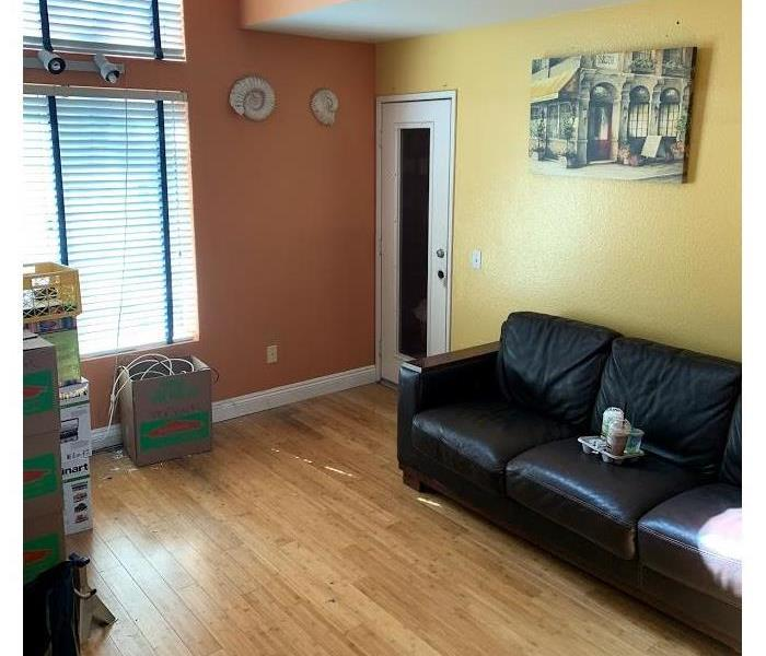 After photo of family room with no contents