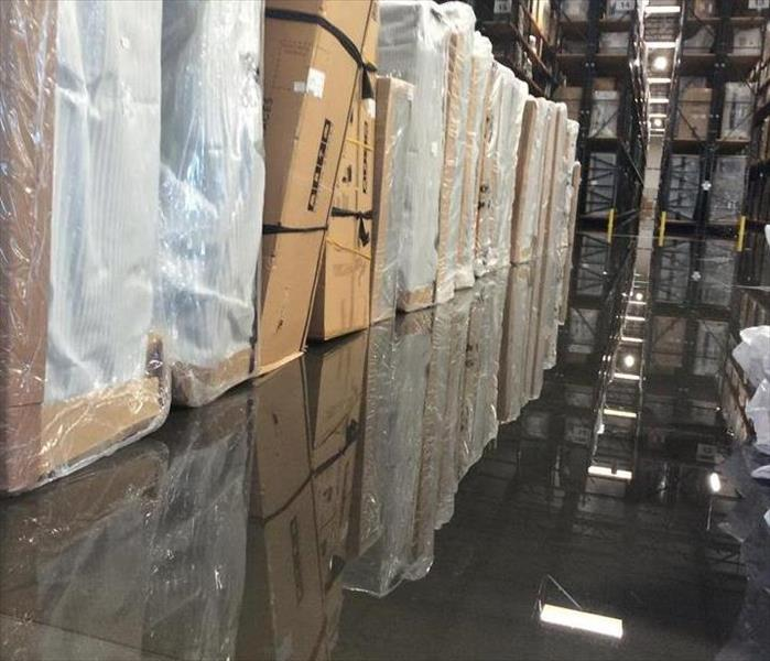 warehouse full of boxed furniture that have water damage